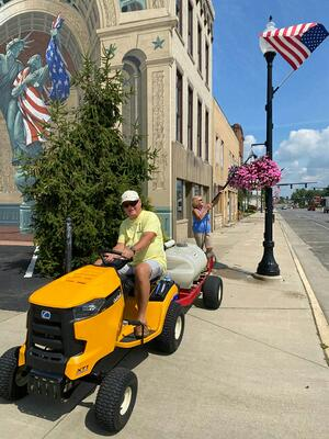 Harold and Marylyn Strang watering hanging baskets in downtown Bucyrus 2020